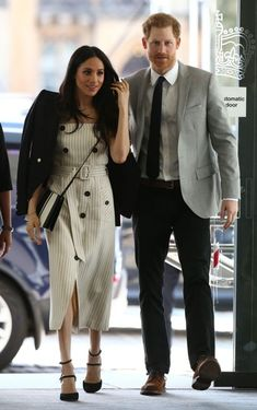 Megan Markle welcomed the sunshine (it is the hottest day of the year so far, after all) in a  pinstripe midi dress by Altuzarra and teamed the look with a blazer draped across her shoulders (as all major fashion players do). #princeharry #meganmarkle #royalwedding#wedding#royals #shopthelook #SpringStyle #SummerStyle #WearToWork #OOTD