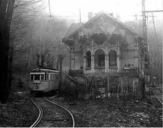 "This is eerie looking. A haunting crackling voice comes across the ghostly speaker's echoing out the broken windows and down the open boarding deck of the train station that's been abandoned for well over 55 years.""all aboard for Capital City. Abandoned Buildings, Abandoned Mansions, Old Buildings, Abandoned Places, Spooky Places, Haunted Places, Abandoned Train Station, Belle Photo, Old Houses"