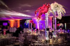 Beautiful tall centerpieces that enhance the beauty of your wedding reception room are a must. #memorymakerdj #weddingdecor #centerpiece
