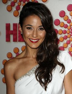 Asymmetrical hairstyles, like Emmanuelle Chriqui's side swept 'do, break up a perfectly symmetrical square face. Creating waves like Emmanuelle's with a curling iron also adds an asymmetrical element as well.