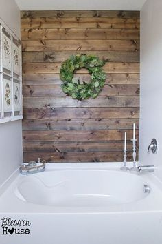 DIY Rustic Bathroom Plank Wall Has two coats of marine grade polyurethane to protect it.