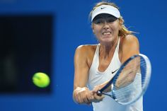 Maria Sharapova Photos: 2014 China Open - Day 8. Maria Sharapova of Russia plays a backhand in her match against Ana Ivanovic of Serbia during day eight of the China Open at the China National Tennis Center on October 4, 2014 in Beijing, China.