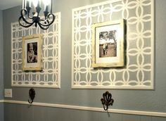 stenciled wall frames... (you could also stencil a very wide mat for a less permanent – and changeable – effect).