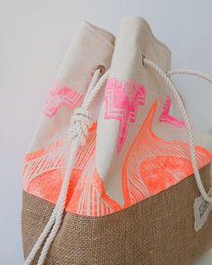 The Sandbag - Special Edition - Surf Tribe Pink & Orange Neon Tribal Print Beach Bag  A brand new edition of our most popular beach tote, done up for summer with a rad boho print. Chapman at Sea classic natural washed canvas is hand stamped with a custom tribal pattern in neon pink and orange. It gives it a really fun, retro - surf vibe. I design & carve all of my own stamps and apply the patterns using water based screen printing ink.  The Sandbag was designed to prevent sand from sneaking…