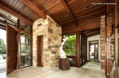 Attractive thermal mass in the stone floor and columns for heat capture and temperature mediation.