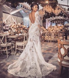 Vera Wang Bride wedding gowns when she wed longtime love Kevin Hart! For the reception, Parrish wore a long-sleeved, sheer fit-and-flare silhouette with a sexy backless detail. See the pics!