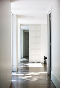 :: INTERIORS :: for a more conservative interior, simple full height detailing and the heavy flush baseboards make for a great pairing with the wide plank wood floors #interiors