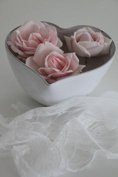 Roses floating in a heart-shaped bowl