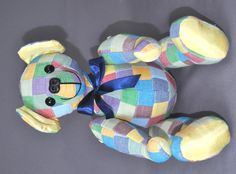 "Kathy had received a memory bear in the past and wanted one to remember a good friend. She sent a pretty patchwork shirt that was once her friend's to make this pretty bear from.  ""I'll continue to think of my friend every time I look at the sweet bear you made from his patchwork shirt. Thanks!  Kathy"""