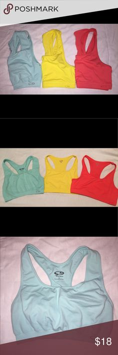 Champion Sports Bras 3 Champion Sports Bras. All size medium. Yellow and coral/orange ones are the same style. Light blue one is a little thicker and seems to have more compression. All in great condition! Champion Intimates & Sleepwear Bras
