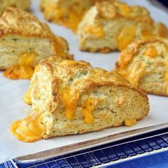 Light flaky buttermilk biscuits with fragrant chives and melting pockets of cheddar cheese baked right in; terrific served with chili, soups or stews or as the start of delicious breakfast sandwiches.