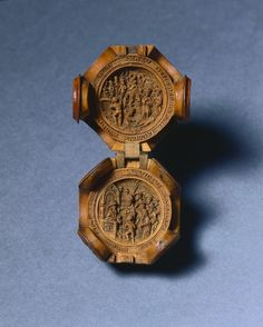 """c. 1500-1530 Carved boxwood paternoster bead, South Netherlands (2 1/4 x 1 7/8 in.) """"Prayer nuts or """"paternosters"""" are generally made from boxwood and carved with extreme refinement and delicacy with openwork Gothic tracery. They came into fashion as private devotional accessories in the Netherlands in about 1500 to 1530. About 50 prayer nuts are still known to survive."""" Cleveland Museum of Art 1961.87"""