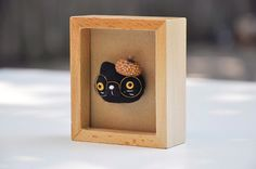 Needle felted brooch pin-Nerdy Cat Pin-black cat  Add this nerdy cat pin to your brooch collection! You can attach it to your totes, scarves, shirt collars and etc. It makes the perfect gift for any cat lover! The cat pin is needle felted from high-quality wool in a smoke-free environment. His tiny beret is made of natural acorn cap and his eyes are made of handcrafted glass eye beads. The metal pin back is hand stitched onto the back…