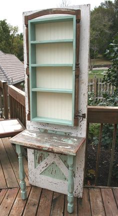 Table and shelf unit fashioned of vintage screen door and lumber (130+ years). This charming piece adds warmth to any room.  Check it out at Copper Rabbit, 414 Main Street, Weston, MO.