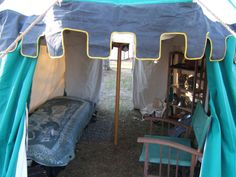 Ok, the tent of a single man, but there might be something in the armor-on-a-bookshelf idea...