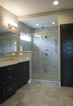 Gray marble look porcelain floor and wall tile with dark cabinets  |  Master Bathroom Inspiration