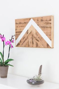 This piece would look amazing hanging on a wall! This reclaimed wood wall art, a mix of earthy materials and contemporary shapes, adds a hint of modern flair to any room. Designed and crafted by hand, (mix wood)