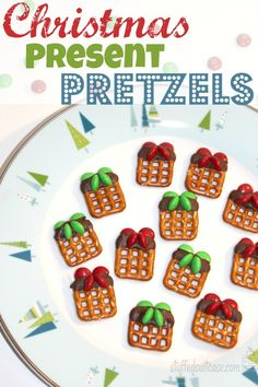 Christmas Present Pretzels [tutorial] : square pretzels dipped in chocolate + m&m's for bow