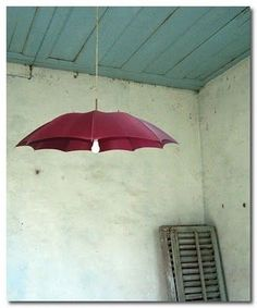 Umbrella light...so creative!  maybe with raindrops painted on the wall behind , even a rainbow (in muted colors or in bright colors for a playroom:-)