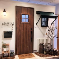Interior examples about the entrance / entrance / Sankyo Aluminum / Wind entrance door / Fanova / Deco window / entrance door. Entrance Doors, Minimalist Living, Front Porch, Coffee Shop, Entryway, Design Inspiration, House Design, Windows, Interior