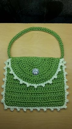 Cute green bag finished off with a picot stitch