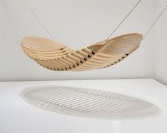 thedesignwalker: Adam Cornish's Wooden Hammock The progressive, award-winning designs of Australian artist, Adam Cornish straddle the line between fine art and furniture. His wooden hammock is constructed from one piece of plantation-grown plywood modeled after the human spine providing perfect posture in the prone position.