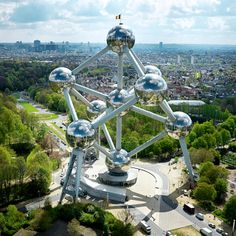 Do you want to visit the Atomium in Brussels, Belgium? The 335-foot-tall structure is shaped like a unit cell of an iron crystal that has been magnified about 165 billion times.