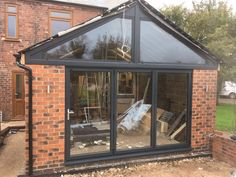 A 3 pane AluK aluminium bi folding door in RAL 7016 Anthracite grey with a Kömmerling UK shaped Upvc frame in matching Anthracite Grey. Installed in Kimberly, Nottingham. House Extension Plans, House Extension Design, Extension Designs, Rear Extension, Extension Ideas, Modern Conservatory, Window Company, House Extensions, Kitchen Extensions