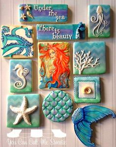 Under the sea cookies. Decorated cookies, using molds and white fondant then hand painting details.
