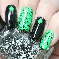 Neon green and black studded nails by decorateddigits