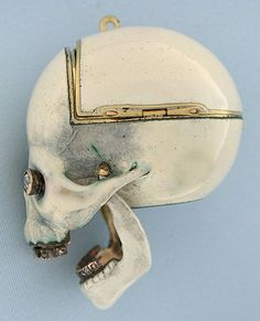 Memento Mori, loosely translated as remember you must die. It is a phrase used to describe a whole range of objects that were designed to remind their owners that life was fleeting, like the passage of time. Dating from around 1810, the Skull Watch is crafted in 18K gold and studded with diamonds set eyes and teeth.