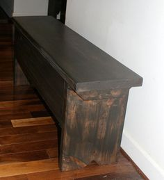 4 foot bench with storage by ModernRust on Etsy, $155.00 + 100$ (shipping). Made to order. with any finish you as for. Great to think about for future apartment.