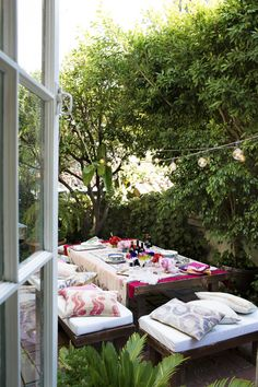 Outdoor living....white-cushioned benches with throw pillows