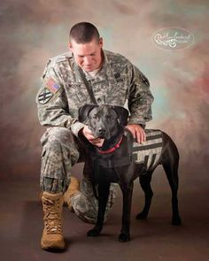 """K9s for Warriors graduate team David & Wilco. Photo courtesy Dog Bless You's Facebook page. (""""Dog Bless You"""" Philanthropist Donates 170 Dogs to Veterans   Dogster)"""