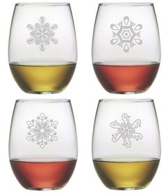 Beautifully etched Abstract Snowflakes adorn each of these stemless wine glasses.