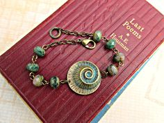 Sea shell bracelet beach jewelry ocean jewelry rustic Boho jewelry verdigris patina seashell fun summer jewelry nickel free by MyLoveAndMe on Etsy  browse even more bohobabe style at https://naturaledgestyle.com