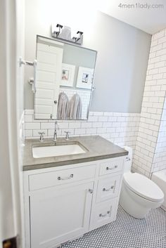 Ready to see an old, dated bathroom? Here you go. After: We shrunk the bathroom by almost three feet. It was a real hot button between the Mr. and I. I was the one who didn't want to move the…