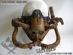 Post apocalypse costume Creepy Doll's Head Gas Mask. Made by Mark Cordory Creations. www.markcordory.com
