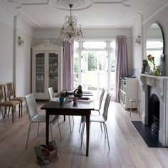 Flavia: House to Home - Dining Room with Fireplace - dining table, white chairs, fireplace and ...