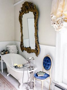 Ever considered putting an ornate mirror in the bathroom for an elegant twist?