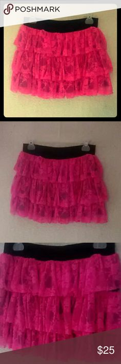 Hot pink Tu-Tu Hot pink Tu-Tu Tu-Tu has three layers of hot pink lace Lace has a floral pattern design Black underneath the pink.   Lace: 90%polyamide 10%elastane Lining: 100%polyester  XL---lengtg 36.5cm, width 36cm Claire's Skirts