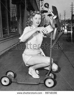 stock photo : Young woman wants her scooter to fly