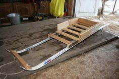 recycling old skis for wooden toboggan