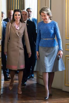 Queen Mathilde of Belgium (R) welcomes Jordan's Queen Rania (L) before a meeting in Brussels on January 12, 2016