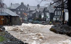 The Ulls Water roars through the centre of Glenridding in Cumbria, as Storm Frank begins to batter the UK on its way towards flood-hit areas