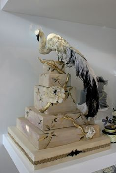 cake opera company - WOW, that's an impressive peacock topper!