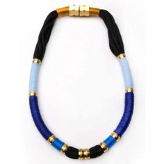 Blue Moon Necklace   Contrasting light and dark blue hues result in a dramatically-cool effect with this Blue Moon Necklace from New York label Holst + Lee. Let the pigments pop and wear it over separates in solid shades.     Shown here in Blue. Made with brass fixtures, nylon thread, Egyptian cotton thread, copper and magnet closure finishing.     This item features magnet closures and can be combined with other Holst + Lee items.