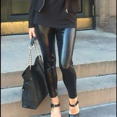 Vegan liquid leather leggings Slick black leggings - new wardrobe staple. Style with black on black in different textures or pair with a vivid plaid to add an edge. Slick black leggings include soft coating interior and two functional back pockets. Pants Leggings