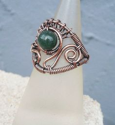 This handmade Moss Agate ring has an earthy woodland inspired beauty you will love. Made with oxidized copper wire and a single Moss Agate bead. A unique wire ring you will only find at Kissed By Clover! US size 5.5 UK size K 1/2 EURO size 50 1/4 * Made with genuine copper wire. If