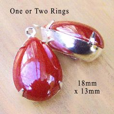Red glass cabochons - teardrop shaped, great for earrings and pendants, $3.89/pr in silver or brass settings